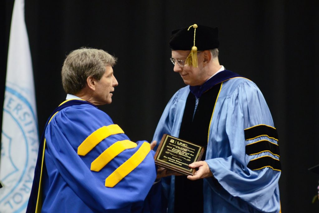 Vincas Steponaitis (right) receiving the Faculty Award for Excellence in Doctoral Mentoring from Graduate School Dean Steve Matson