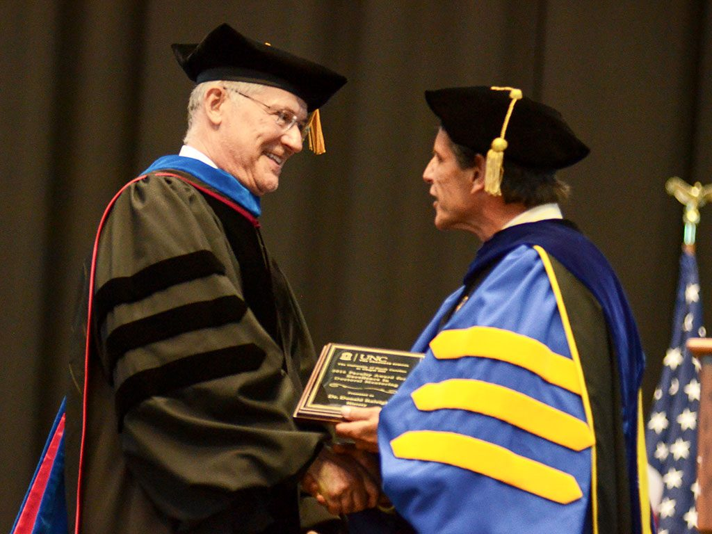 Donald J. Raleigh receiving the Faculty Award for Excellence in Doctoral Mentoring from Graduate School Dean Steve Matson