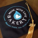 Norman's decorated mortarboard celebrating her new social venture