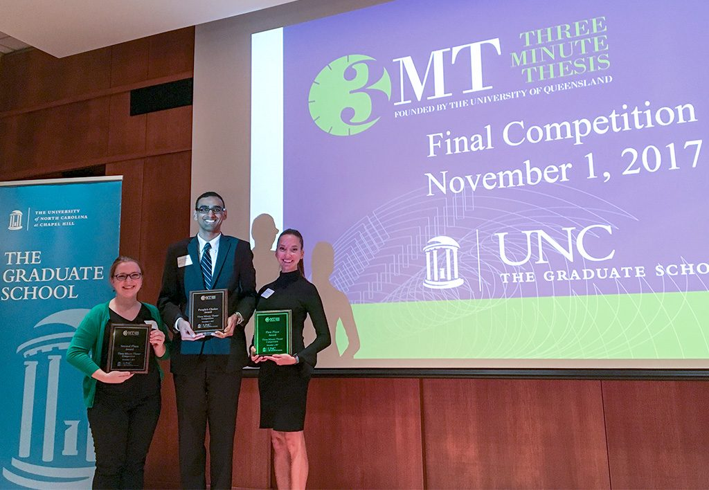 Three Minute Thesis awardees Nicole Kahn (runner-up), Aaron Devanathan (people's choice) and Katelyn Arnold (first place).