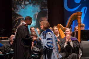 Mike Wiley receives UNC's Distinguished Alumnus Award from Chancellor Carol Folt