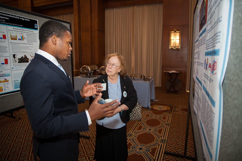 Graduate student Javonte Lipsey, a GPSF Graduate Research and Policy Expo honoree, discusses his research with Penny Aldrich.