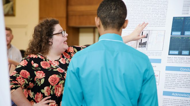 Rising junior Emma Halker presents her research at the George Watts Hill Alumni Center