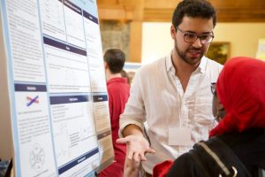 Student shares his research findings with the campus community