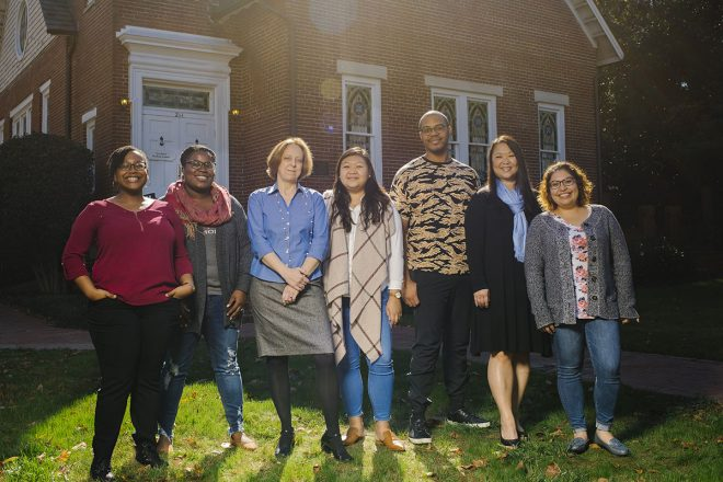 The Graduate School's Diversity and Student Success Program staff stands in front of The Graduate Student Center on campus.